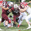 Hunter Crofoot helps block for Joshua Cramer as he scores for Dundee, Saturday, Sept. 29.