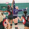 Hammondsport's Erika Hilligus jumps at the net to spike the ball, Saturday, Oct. 27 at Prattsburgh.