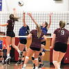Serina Sheradin and Kayla Andersen reach for the ball in the New York State Public High School Athletic Association tournament last weekend.