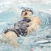 Watkins Glen's Peighton Cervoni swims to victory in 100 yard backstroke.