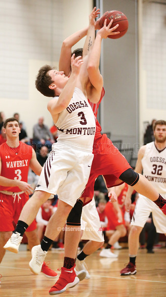 Noah Angle jumps for a rebound in the Thursday game against Waverly.