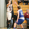 Wylie Hall puts up a three-pointer in the sectional game against Kendall.