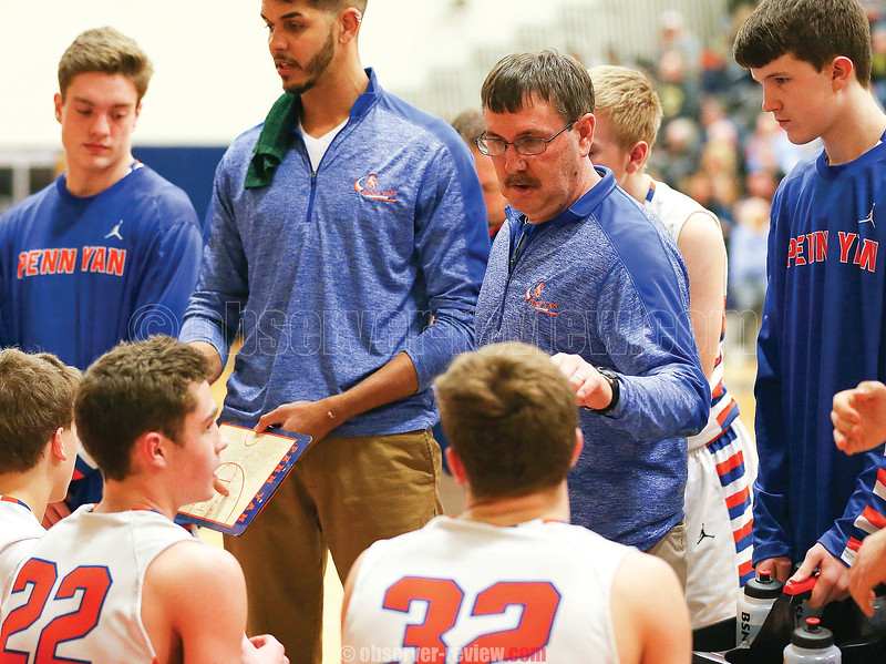 Section V Class B Coach of the Year Marty Gibson talks to his team during a timeout last Saturday.
