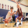 Derrick Rivello charges to the basket for Penn Yan in the sectional game, Saturday, Feb. 24. The Mustangs defeated Wayland-Cohocton 75-48.