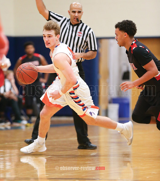 Desmond Battin moves the ball for Penn Yan in the closing seconds of the basketball game Friday, Feb. 2.