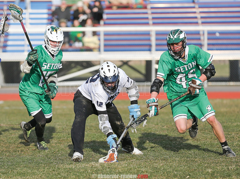 Joe Chedzoy scoops up a ground ball in the game Thursday, April 5.