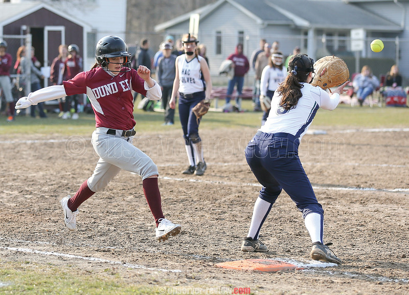 Haille Empson races the ball to first base Friday, April 13. She was called out.