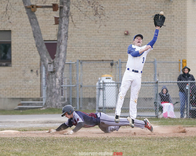 Derrick Lewis dives safely into third base, Wednesday, April 11 against Candor.