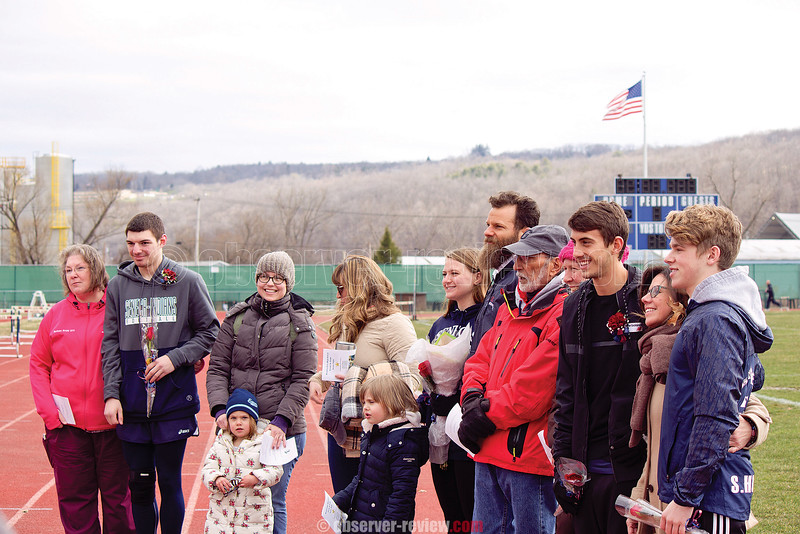 Seniors Alex Schimizzi, Isobel Scheffey, Aaron Planty and Sean Holland pose for a photo with their families during senior night, Wednesday, April 18. Photo by: Briana Taft