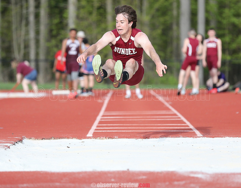 William Hall jumps in the long jump event for Dundee, Monday, May 14.