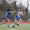 Sydney Bloom runs away from two defenders in the game against Maine-Endwell.