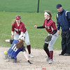 Makenzie Cratsley and Alexandria Wood cover second base as a runner slides in Friday, April 27.