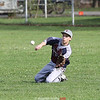 Josiah Wysocki slides to catch a fly ball in the game last Friday.