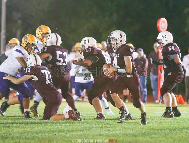 Dundee quarterback Preston Cratsley (4) moves in the pocket during the game against Clyde-Savannah.
