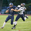 Joe Chedzoy gives a stiff arm to gain yardage for the Seneca Indians, Saturday, Sept. 8.