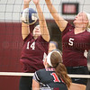 Makenzie Cratsley and Alyssah Newell go up at the net trying to block a spike Monday night.