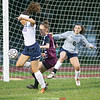 Odessa's Lexi Saunders (center) works in front of the goal as Natalie Edmister and Cierra Barber defend.