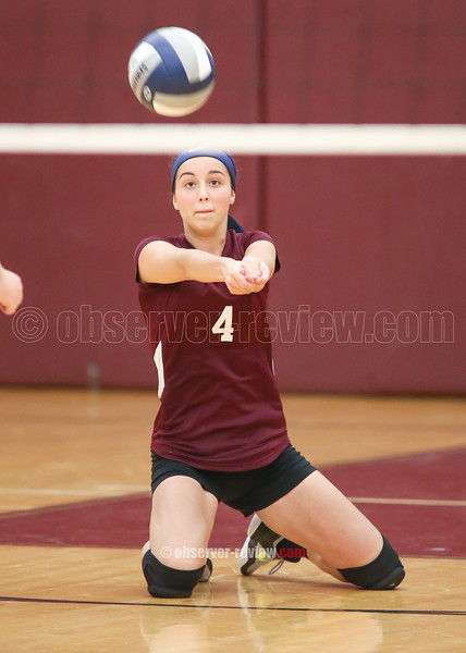 Mackenzie Strait records a dig for Dundee against Campbell-Savona.