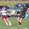 Madison Everetts crosses the ball in the game last week.