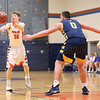 Colton Smith passes the ball to a teammate Friday, Jan. 18 against Wayne.