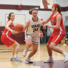Hallie Knapp drives into the lane during the game last week.