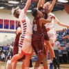 Kyler Lloyd and Mason Kuver go up under the basket to try and grab a rebound.