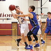 Mitchell Pike defends the ball from a Candor player, Friday, Jan 4.