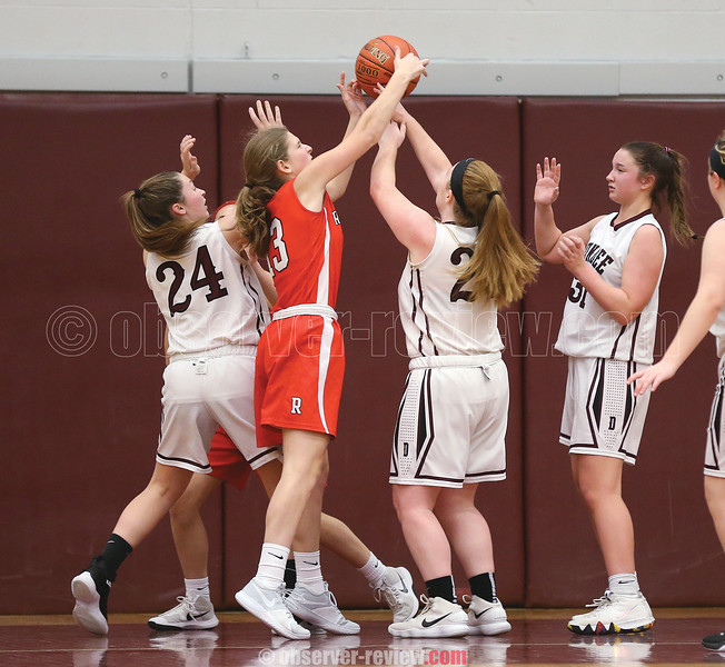Dundee's Makenzie Cratsley and Megan Sutherland reach for a rebound against Red Jacket, Friday, Jan. 4.