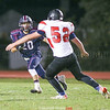 Dominick Fazzary carries the ball for yardage against Newark Valley.