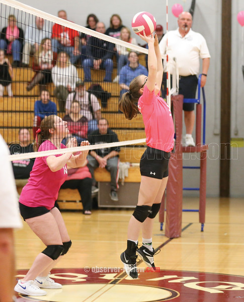 Dundee's Lily Hall (right) jumps to help the ball get over the net, Wednesday, Oct. 16.