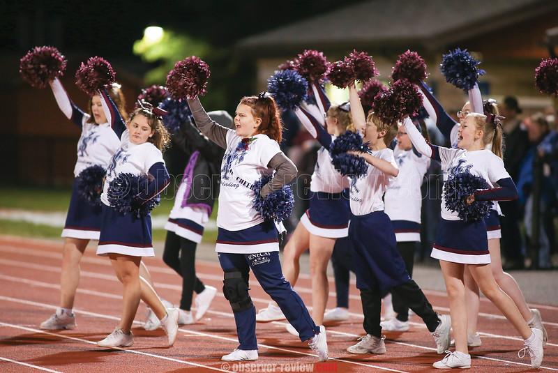 The Watkins Glen cheerleading squad leads a cheer, Saturday night at Watkins Glen.