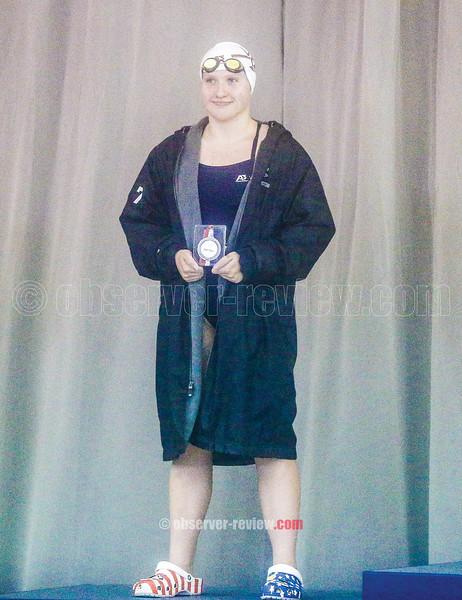 Amanda Wilbur receives her second place award in the Saturday meet.