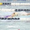 Katie Adams swims in the backstroke event at the IAC championship last weekend.