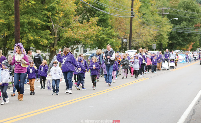 Students and teachers marched the parade route from the school to the village square and back, last Friday.