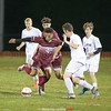 Preston Harris moves the ball away from the defenders, Thursday, Oct. 4.