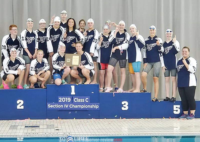 The Watkins Glen girls swim team gathers on the podium for a team photo, last Saturday. PHOTO PROVIDED