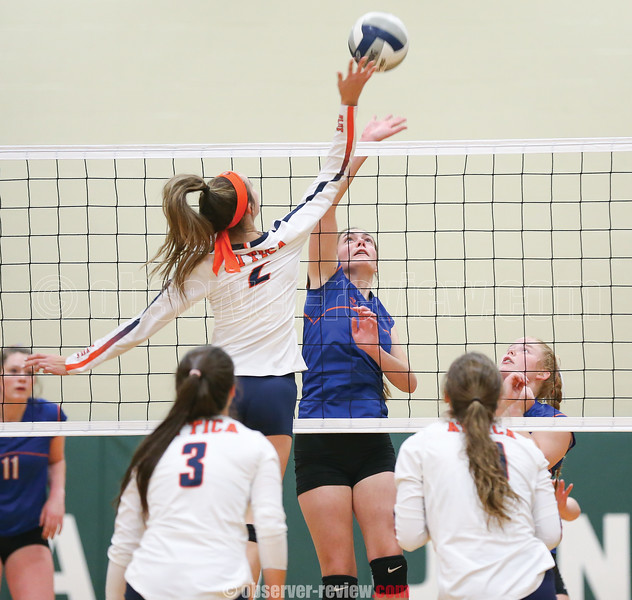 Kayla Andersen jumps to block the ball Friday, Nov. 8 in the sectional championship game.