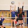 Caitlin Wunder returns the ball against Waterloo in the sectional quarterfinal, Saturday, Nov. 2.