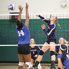 Julia Bennett scores a point for the Lakers with a spike against Houghton.