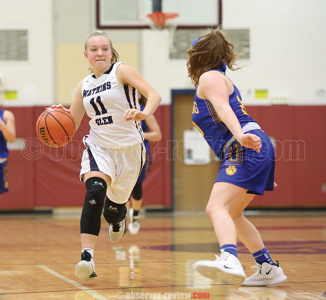 Abby Gibson drives to the basket, Friday, Dec. 6.