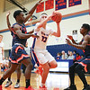 Peter Nicholson shoots from under the basket last week.