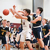 Cayden Confer reaches for a rebound in the game against Tioga, Friday, Dec. 13.