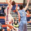 Kyle Berna goes up under the basket to get a shot off last week.