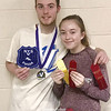 Dundee's Matt Wood and Lily Hall have a photo taken with their Section V track awards, last Friday. Photo Provided
