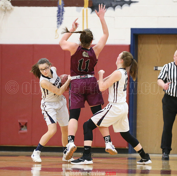 Jena Slater and Kelsey Kernan work to cause a turnover, Friday, Feb. 22.