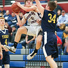 Isaac McIlroy goes to the basket, Thursday, Feb. 21.