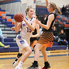 Jenna Curbeau drives to the basket, Saturday, Feb. 2 against Waterloo.