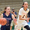 Hannah Morse (3) moves the ball against Cambridge's Sophie Phillips (2) in the New York State Public High School Athletic Association Class C championship basketball game Saturday, March 16, in Troy. (Photo Hans Pennink)