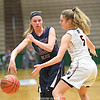 Danielle Leszyk (23) passes the ball around Cambridge's Stasia Epler (5) in the state final game at Hudson Valley Community College last Saturday. Cambridge won the game 57-43. (Photo/Hans Pennink)