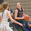 Adrienna Solomon (20) looks for a teammate as two Cambridge defenders approach, last weekend in the state game. (Photo Hans Pennink)